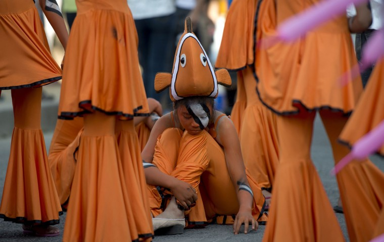 Students wearing fish costumes wait for their turn to dance during the annual Caracol Festival in Manila on February 22, 2015. Participants of the Caracol Festival dress in different costumes of wildlife and endangered species to express the need to preserve Manila's environment and cultural heritage. (Noel Celis/AFP/Getty Images)