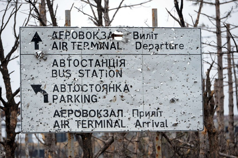 This photo shows a pierced by shrapnel road sign near the destroyed airport in the eastern Ukrainian city of Donetsk, on February 26, 2015. Ukraine's military said Thursday it was starting the withdrawal of heavy weapons from the frontline with pro-Russian rebels, a key step in a stuttering peace plan. The start of the withdrawal by Kiev comes after a shaky truce that was meant to come into force February 15 finally took hold across the Ukraine conflict zone in recent days. (Vasily Maximov/AFP/Getty Images)