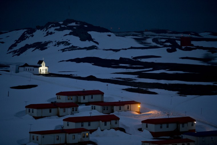 In this Jan. 20, 2015 photo, a church is lit in the town of Villa Las Estrellas on King George Island, Antarctica. Geologists are entranced by Antarcticaís secrets. Clues to answering humanity's most basic questions are locked in this continental freezer the size of the United States and half of Canada: Where did we come from? Are we alone in the universe? What's the fate of our warming planet? (AP Photo/Natacha Pisarenko)