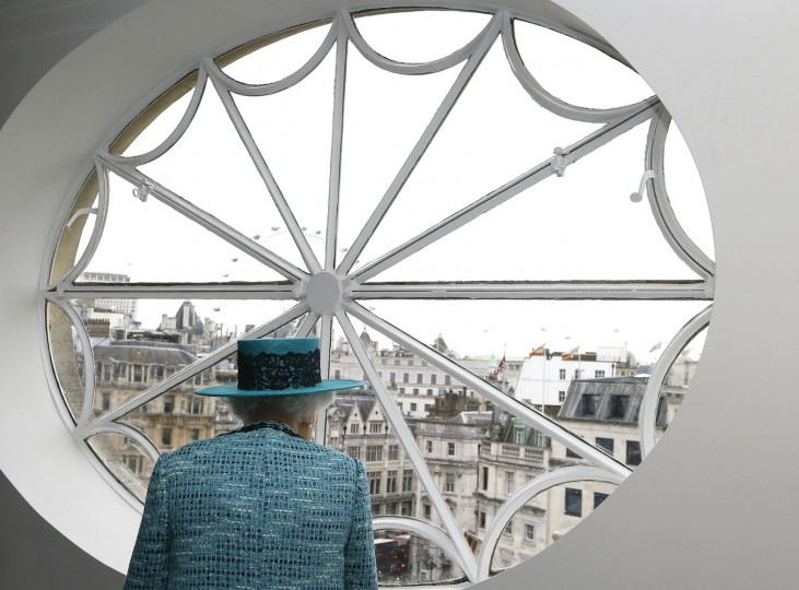 Britain's Queen Elizabeth II looks at the view out of a window, during a visit to reopen Canada House, following an extensive programme of restoration and refurbishment, in London, Thursday, Feb. 19, 2015. Canada House is the official home to the Canadian High Commission in the United Kingdom. The building was first opened in 1925 by King George V. (Kirsty Wigglesworth/AP Photo/Pool)