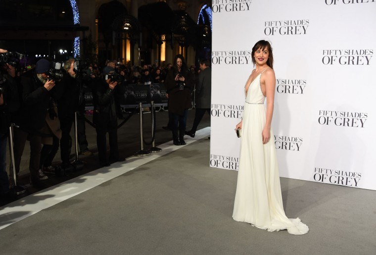 Dakota Johnson poses for photographers at the UK Premiere of Fifty Shades of Grey, at a central London cinema, Thursday, Feb. 12, 2015. (Jonathan Short/Invision/AP)