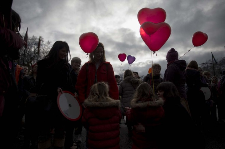 Women and girls hold love heart shaped balloons during a day of action event with a theme of love revolution and a focus on healthy relationships organized by the One Billion Rising movement at Marble Arch in London, on Valentine's Day. One Billion Rising is so named to give awareness to the statistic that one in three women in the world will be raped or beaten in their lifetime which equates to one billion women. AP Photo/Matt Dunham