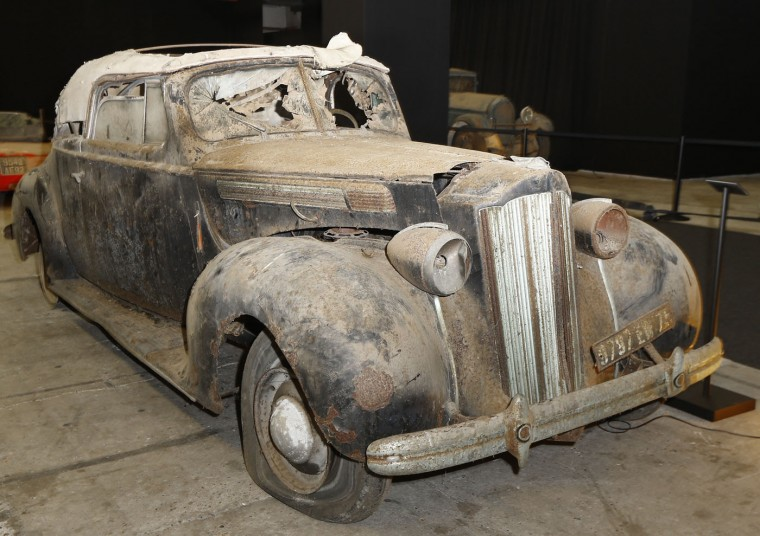A Packard Eight Cabriolet displayed during a preview for an auction of vintage cars Retromobile show in Paris, Tuesday, Feb. 3, 2015, after a treasure trove of classic cars was discovered after spending 50-years languishing in storage on a farm. 60 rusting motors, which include a vintage Ferrari California Spider, a Bugatti and a very rare Maserati, were found gathering dust and hidden under piles of newspapers in garages and outbuildings at a property in France. The cars were collected from the 1950s to the 1970s by entrepreneur Roger Baillon, who dreamt of restoring them to their former glory and displaying them in a museum, but, his plans were dashed as his business struggled, forcing the sale of about 50 vehicles, to be auctioned off on Feb. 6. (AP Photo/Jacques Brinon)