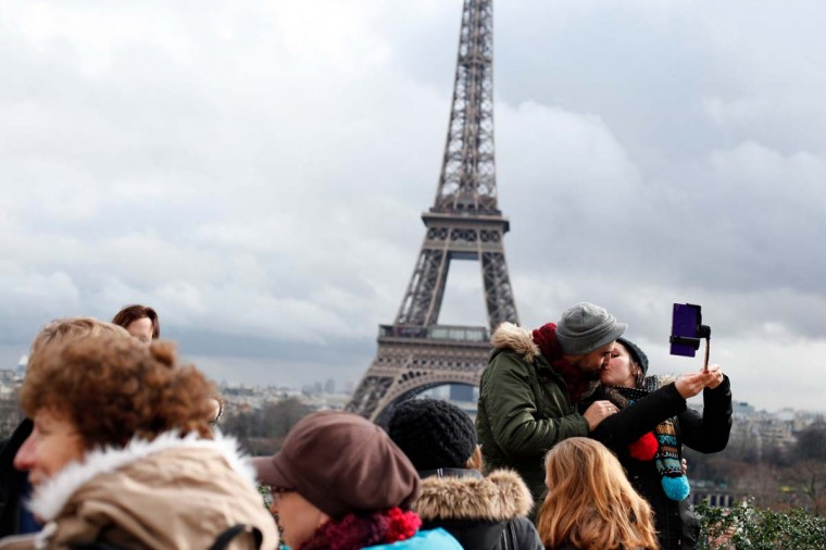 A couple kiss in front of the Eiffel Tower, during Valentine's day in Paris. Valentine's Day is observed on February 14 each year as a special day to celebrate love and romance. AP Photo/Thibault Camus