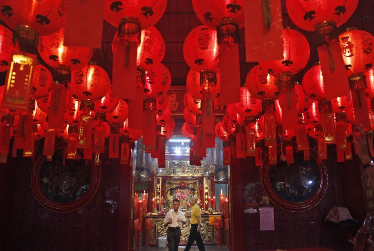 Indonesians of Chinese descent attend a prayer during Chinese New Year celebration at Dharma Sakti temple at the China Town in Jakarta, Indonesia, Thursday, Feb. 19, 2015. Ethnic Chinese in the world's most populous Muslim country are celebrating the start of the year of the sheep. (Dita Alangkara/AP Photo)
