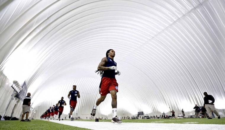 Floyd Raven, of Texas A&M, runs with other draft-eligible players at the NFL football regional combine at the Houston Texans' training facility in Houston. Players that do well at the regional combine will be invited to attend the NFL super regional combine. AP Photo/David J. Phillip
