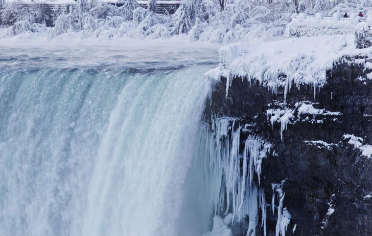 Visitors look over masses of ice formed around the Canadian Horseshoe Falls in Niagara Falls, Ontario, Thursday, Feb. 19, 2015. (AP Photo/The Canadian Press,Aaron Lynett)