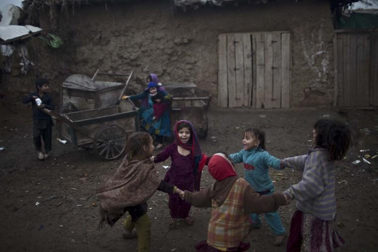 Afghan refugee girls play in a slum on the outskirts of Islamabad, Pakistan, Monday, Feb. 2, 2015. (AP Photo/Muhammed Muheisen)