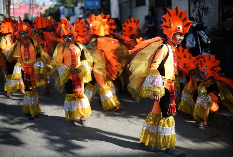 "Filipino students dressed as fish wait for their turn during the annual ""Caracol"" festival in suburban Makati, south of Manila, Philippines on Sunday, Feb. 22, 2015. The event aims to promote public awareness on environmental issues and cultural heritage. (AP Photo/Aaron Favila)"