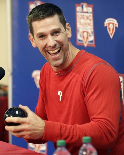 Philadelphia Phillies starting pitcher Cliff Lee laughs as he holds an Magic Eight ball before responding to a question during a news conference at spring training baseball, Thursday, Feb. 19, 2015, in Clearwater, Fla. (Lynne Sladky/AP Photo)