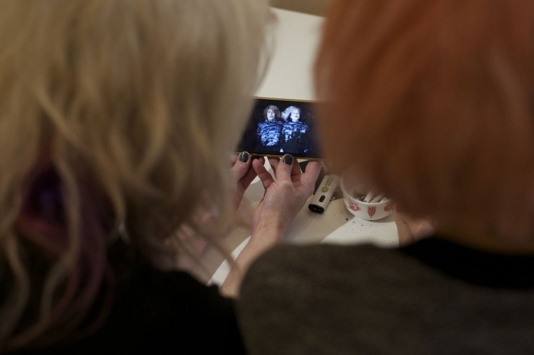 "Two members of the punk provocateur band Pussy Riot Maria Alekhina, left, and Nadezhda Tolokonnikova watch their music video on a phone during an interview with The Associated Press in Moscow, Russia, Thursday, Feb. 19, 2015. Two members of the punk provocateur band Pussy Riot have released a new music video dedicated to Eric Garner, an unarmed man who was killed when a New York City police officer put him in a fatal chokehold. In the video the are dressed in Russian riot police uniforms and shown buried alive. The song is titled ""I Can't Breathe,"" the last words of Eric Garner captured on video by a bystander. (Ivan Sekretarev/AP Photo)"