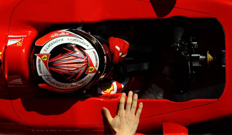 Kimi Raikkonen of Finland and Ferrari is pulled by technicians to the garage during the 2015 Formula One testing at the Barcelona Catalunya racetrack in Montmelo, Spain, Thursday, Feb. 19, 2015. (Manu Fernandez/AP Photo)