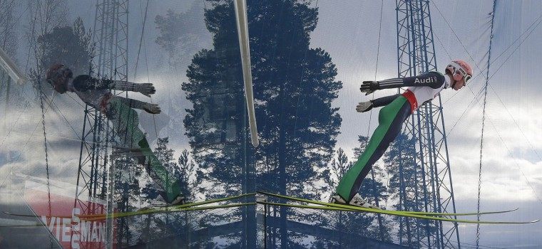 Germany's Severin Freund is reflected as he jumps during a training session for the Ski Jumping event at the Nordic Skiing World Championships in Falun, Sweden, Thursday, Feb. 19, 2015. (Matthias Schrader/AP Photo)