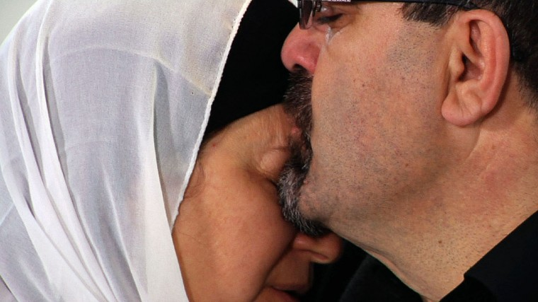 """Namee Barakat hugs his wife Layla during a news conference in Raleigh, N.C., about the death of his son, Deah, his daughter-in-law and her sister on Wednesday, Feb. 11, 2015. Barakat said the death penalty """"would not be enough"""" for Craig Hicks, the man charged with murdering the three Muslim students. (Allen G. Breed/AP)"""