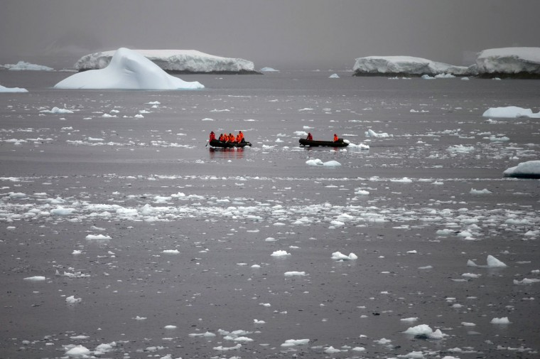 In this Jan. 22, 2015 photo, Chilean Navy officers transport scientists to Chile's Station Bernardo O'Higgins in Antarctica. Because there is no local industry, any pollution captured in the pristine ice and snow is from chemicals that traveled from afar, such as low levels of lead found in ice until it was phased out of gasoline, or radiation levels found from above-ground nuclear tests thousands of miles away and decades ago by the U.S. and the Soviet Union, according to David Vaughan, science director of the British Antarctic Survey. (AP Photo/Natacha Pisarenko)