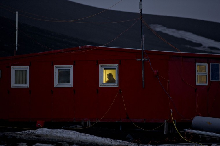 In this Jan. 24, 2015 photo, a scientist stands behind a window on the Spanish base Gabriel de Castilla on Deception Island, part of the South Shetland Islands archipelago in Antarctica. If experts are right, and the West Antarctic ice sheet has started melting irreversibly, what happens here will determine if cities such as Miami, New York, New Orleans, Guangzhou, Mumbai, London and Osaka will have to regularly battle flooding from rising seas. (AP Photo/Natacha Pisarenko)