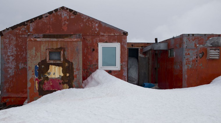 In this Jan. 24, 2015 photo, snow surrounds buildings used by Chile's scientists on Robert Island, part of the South Shetland Islands archipelago in Antarctica. Temperatures can range from above zero in the South Shetlands and Antarctic Peninsula to the unbearable frozen lands near the South Pole.(AP Photo/Natacha Pisarenko)