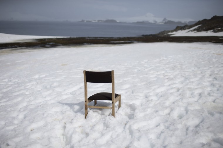 In this Jan. 24, 2015 photo, a chair sits in the snow, left behind by someone who kept watch for a delayed ship, on the Risopatron Base on Robert Island, part of the South Shetland Islands archipelago in Antarctica. Often, scientists find something other than what they were looking for. Last year researchers calculated that ice on the western side of the continent was melting faster than expected. Last month, scientists researching vital geology in that melting were looking half a mile under the ice in pitch dark and found a surprise: fish half a foot (15 centimeters) long and shrimp-like creatures. (AP Photo/Natacha Pisarenko)