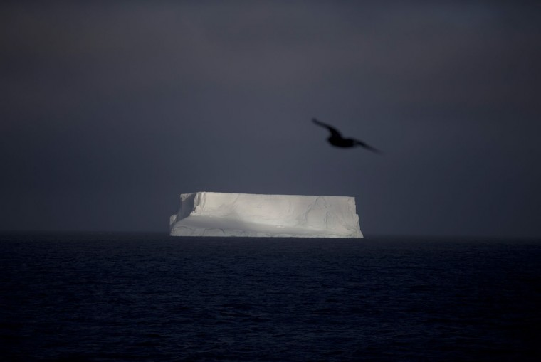 In this Jan. 27, 2015 photo, an iceberg floats in the Bahia Almirantazgo near Livingston Island, part of the South Shetland Island archipelago in Antarctica. Antarctica conjures up images of quiet mountains and white plateaus, but the coldest, driest and remotest continent is far from dormant. The majority of it is covered by ice, and that ice is constantly moving. (AP Photo/Natacha Pisarenko)