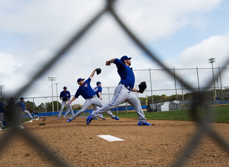 Toronto Blue Jays pitcher Marco Estrada, right, pitches a bullpen session during baseball spring training in Dunedin, Fla., on Tuesday, Feb. 24, 2015. (AP Photo/The Canadian Press, Nathan Denette)
