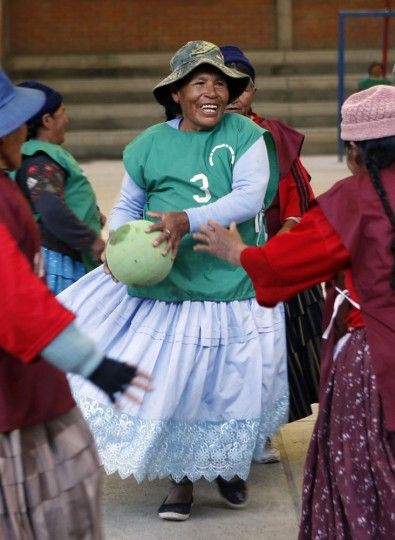 "In this Feb. 11, 2105 photo, 78-year-old Genara Quispe plays handball with other Aymara indigenous elderly women in El Alto, Bolivia. ""This sport makes me feel alive and that I can still run around,"" Quispe said. (AP Photo/Juan Karita)"