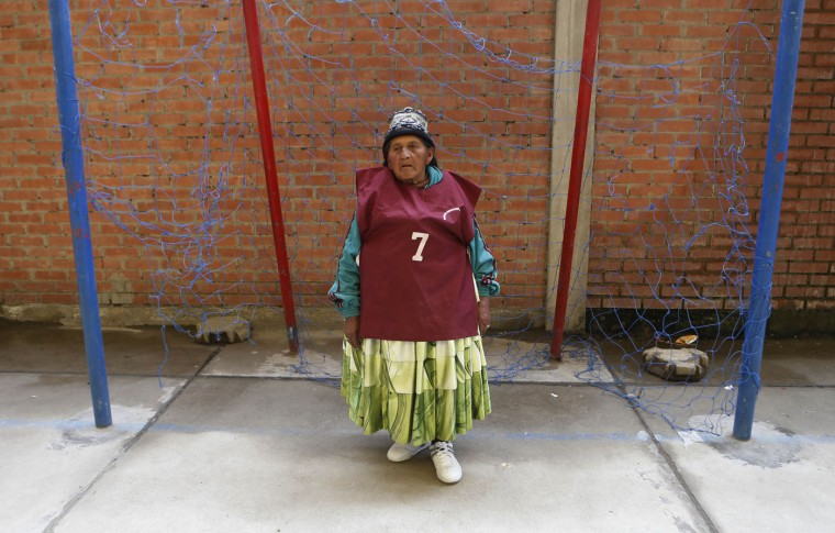 In this Feb. 11, 2105 photo, 84-year-old Juana Poma stands in the goal area during a handball game among elderly Aymara indigenous women in El Alto, Bolivia. ìThis helps us a lot, said Poma, a great-grandmother of five, referring to playing handball. ìLook, Iím full of life, but Iím also thinner.î (AP Photo/Juan Karita)