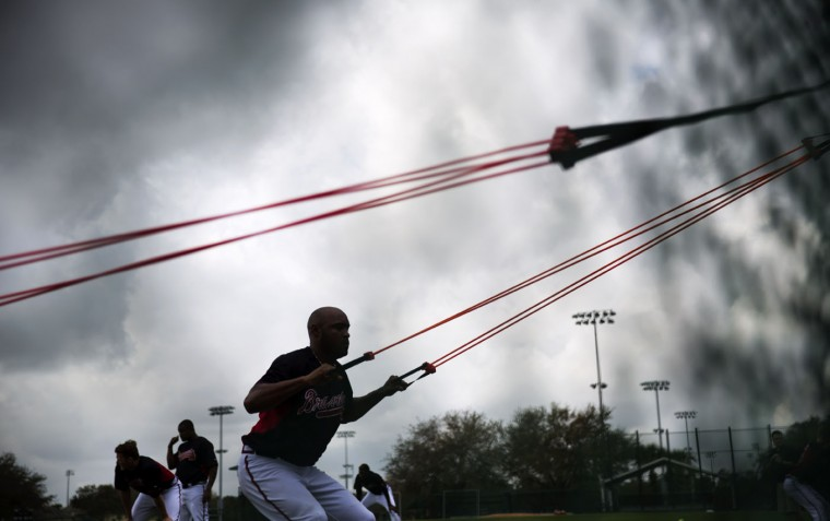 Atlanta Braves pitcher Jose Veras works out with resistance bands during a spring training baseball workout, Monday, Feb. 23, 2015, in Kissimmee, Fla. (AP Photo/David Goldman)