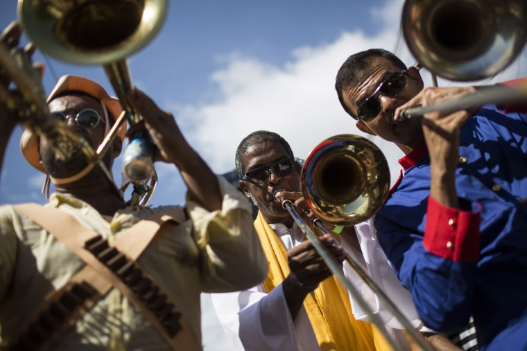 """Revelers play the trumpet during the 'Ceu na Terra', or Heaven on earth, carnival parade in Rio de Janeiro, Brazil, Saturday, Feb. 7, 2015. Rio's over-the-top Carnival is the highlight of the year for many local residents. Hundreds of thousands of merrymakers are beginning to take to the streets in open-air """"blocos"""" parties. (AP Photo/Felipe Dana)"""