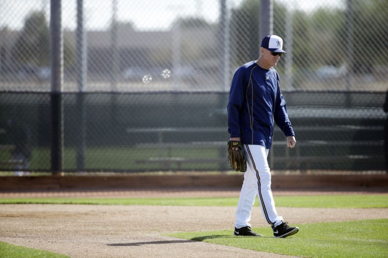 Milwaukee Brewers manager Ron Roenicke watches during a spring training baseball workout Tuesday, Feb. 24, 2015, in Phoenix. (AP Photo/Morry Gash)