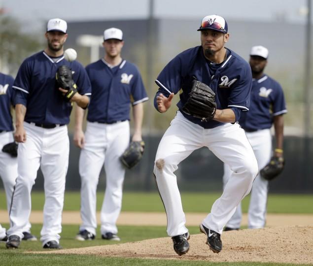 Milwaukee Brewers' Matt Garza catches a ball during a spring training baseball workout Sunday, Feb. 22, 2015, in Phoenix. (AP Photo/Morry Gash)