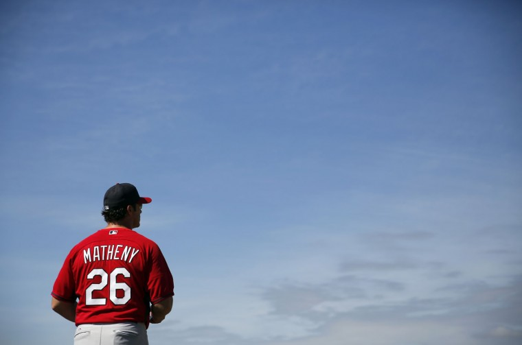 St. Louis Cardinals manager Mike Matheny watches his team during a spring training baseball workout Wednesday, Feb. 25, 2015, in Jupiter, Fla. (AP Photo/Jeff Roberson)