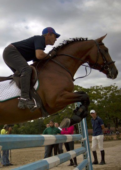 A horse trainer demonstrates his horse's skills during an auction at the National Equestrian Club in Lenin Park on the outskirts of Havana, Cuba. Well-heeled collectors gathered hoping to find a champion among the horses paraded before them. (AP Photo/Ramon Espinosa)