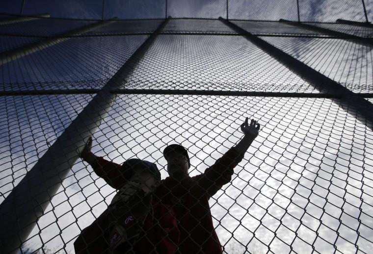 Fans watch as the Arizona Diamondbacks work out during spring training baseball practice Sunday, Feb. 22, 2015, in Scottsdale, Ariz. (AP Photo/Darron Cummings)