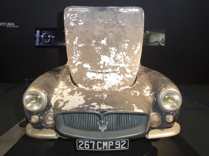 A Maserati A6G 2000 Gran Sport Berlinetta Frua is displayed during a preview for an auction of vintage cars Retromobile show in Paris, Tuesday, Feb. 3, 2015, after a treasure trove of classic cars was discovered after spending 50-years languishing in storage on a farm. 60 rusting motors, which include a vintage Ferrari California Spider, a Bugatti and a very rare Maserati, were found gathering dust and hidden under piles of newspapers in garages and outbuildings at a property in France. The cars were collected from the 1950s to the 1970s by entrepreneur Roger Baillon, who dreamt of restoring them to their former glory and displaying them in a museum, but, his plans were dashed as his business struggled, forcing the sale of about 50 vehicles, to be auctioned off on Feb. 6. (AP Photo/Jacques Brinon)