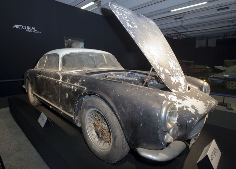 Maserati A6G 2000 Gran Sport Berlinetta Frua displayed during a preview for an auction of vintage cars Retromobile show in Paris, Tuesday, Feb. 3, 2015, after a treasure trove of classic cars was discovered after spending 50-years languishing in storage on a farm. 60 rusting motors, which include a vintage Ferrari California Spider, a Bugatti and a very rare Maserati, were found gathering dust and hidden under piles of newspapers in garages and outbuildings at a property in France. The cars were collected from the 1950s to the 1970s by entrepreneur Roger Baillon, who dreamt of restoring them to their former glory and displaying them in a museum, but, his plans were dashed as his business struggled, forcing the sale of about 50 vehicles, to be auctioned off on Feb. 6. (AP Photo/Jacques Brinon)