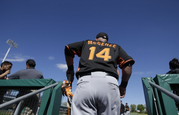 San Francisco Giants' Casey McGehee (14) walks out of the dugout during spring training baseball practice Tuesday, Feb. 24, 2015, in Scottsdale, Ariz. (AP Photo/Darron Cummings)