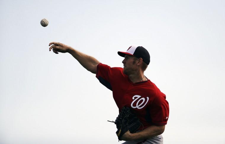 Washington Nationals pitcher Stephen Strasburg throws the ball during a spring training baseball workout, Sunday, Feb. 22, 2015, in Viera, Fla. (AP Photo/David Goldman)