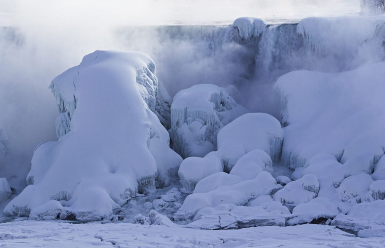 Masses of ice form in the lower Niagara River and around the American Falls as seen from Niagara Falls, Ontario, Canada, Thursday, Feb. 19, 2015. (AP Photo/The Canadian Press/Aaron Lynett)