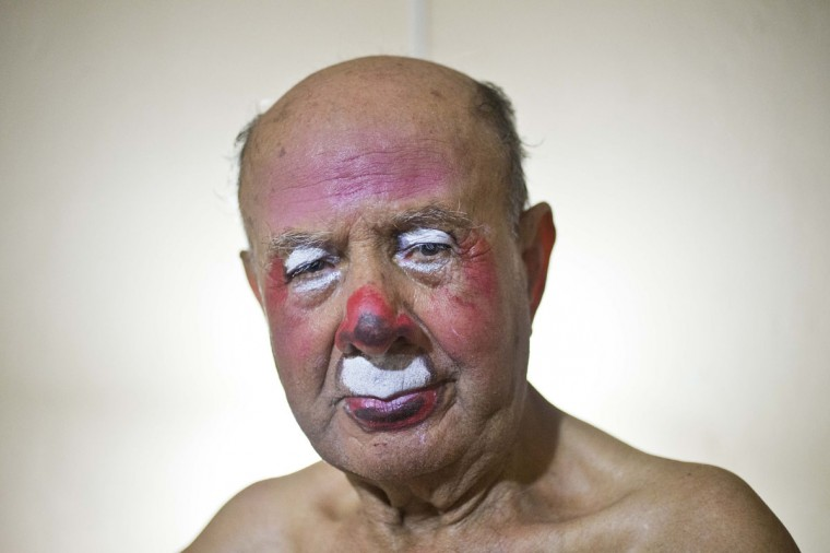 "Veteran clown Ricardo Farfan, popularly known as ""Pitito,"" poses for a portrait after performing at his 91st birthday party in his home in Lima, Peru. Farfan began painting his face to perform as a clown when he was three-years-old, alongside his father who owned the traveling Farfan Brothers Circus. ""Chiminea"" was his father's clown name. (AP Photo/Esteban Felix)"
