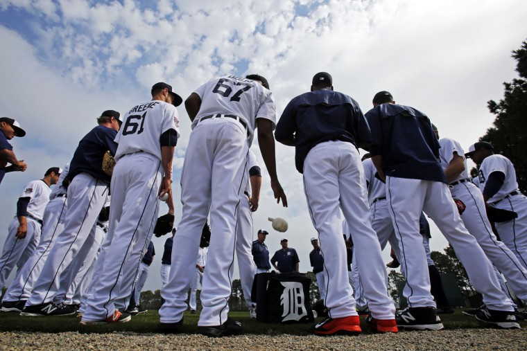 Detroit Tigers pitchers gather on the a practice field for a spring training baseball workout in Lakeland, Fla., Tuesday, Feb. 24, 2015. (AP Photo/Gene J. Puskar)