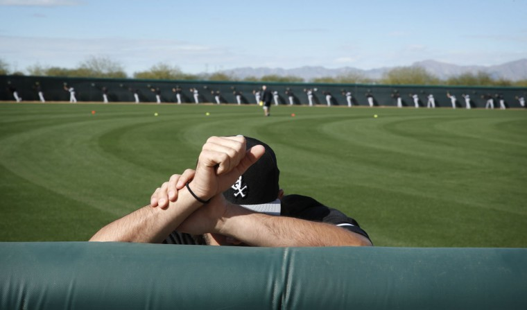 Chicago White Sox's Zach Phillips warms up before a spring training baseball workout Tuesday, Feb. 24, 2015, in Phoenix. (AP Photo/John Locher)