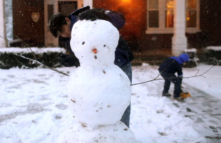 Chris Brink builds a snowman Wednesday, Feb. 25, 2015, in Muscle Shoals, Ala. From the Deep South to the Mid-Atlantic. (AP Photo/The TimesDaily, Allison Carter)
