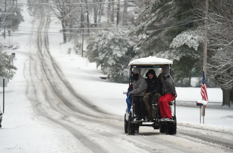 Will Lankford takes six of his friends on a ride in his big buggy golf cart in Gadsden, Ala., Wednesday, Feb. 25, 2015. (AP Photo/AL.com, Joe Songer)