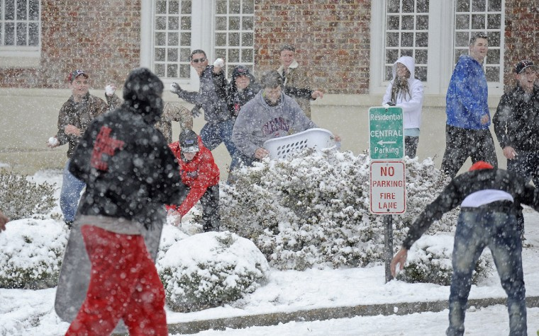 Students have a snowball fight on the University of Mississippi campus Wednesday, Feb. 25, 2015, in Oxford, Miss. (AP Photo/The Daily Mississippian, Thomas Graning)