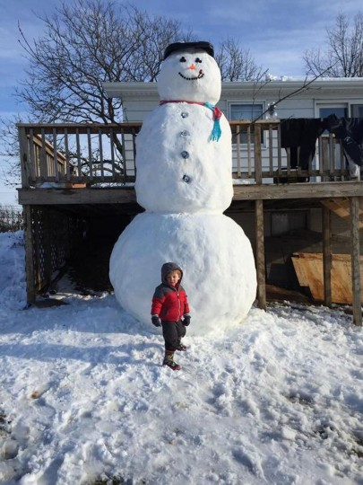 Peyton Goretsas poses with a 14-foot snowman in Manchester. (Photo courtesy of Kelsey Franklin)