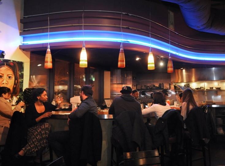 People convene at the bar before the salsa dancing begins. (Algerina Perna/Baltimore Sun)