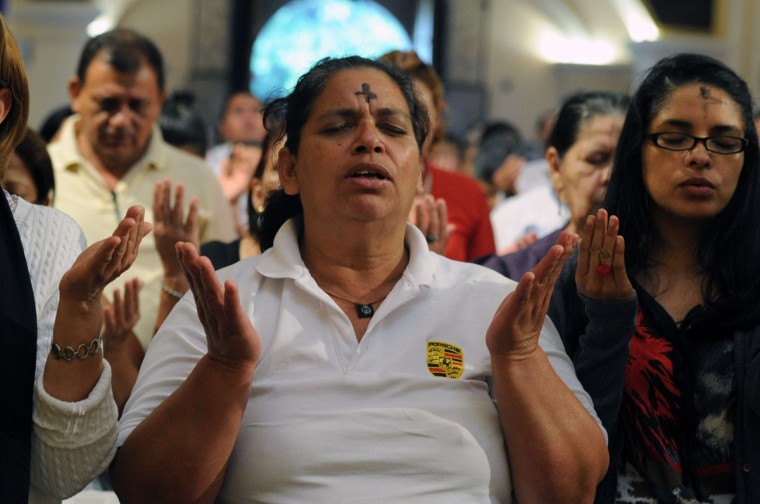 Catholics pray as they celebrate Ash Wednesday, marking the beginning of Lent -- a period of penitence for Christians before Easter -- in Tegucigalpa, Honduras, on February 18, 2015. (ORLANDO SIERRA/AFP/Getty Images)