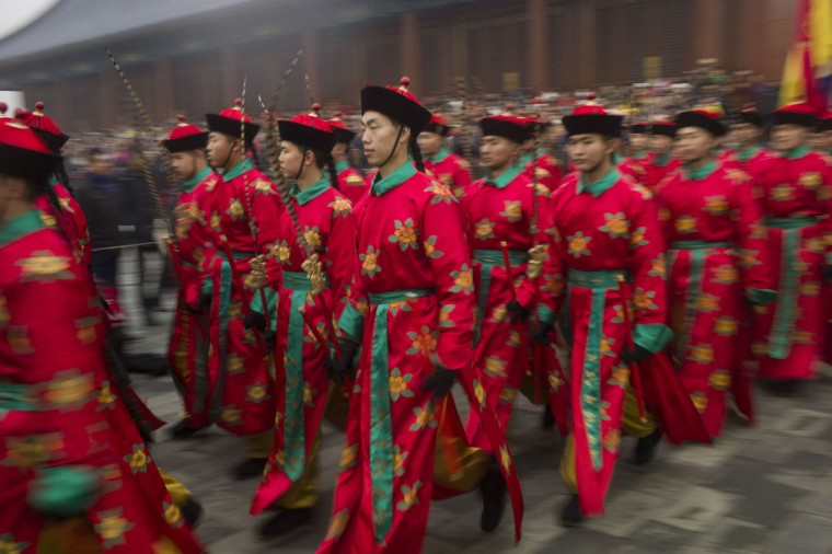 Chinese performers re-enact a traditional Qing Dynasty ceremony in which emperors prayed for good fortune at the Temple of Heaven as part of the Chinese Lunar New Year festivities in Beijing on February 21, 2015. (FRED DUFOUR/AFP/Getty Images)