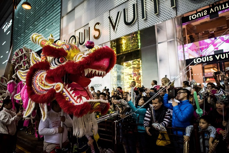 Performers dance at the 2015 Cathay Pacific International Chinese New Year Night Parade on February 19, 2015 in Hong Kong, Hong Kong. The parade featured illuminated floats accompanied by local and international performing groups which entertained both locals and tourists alike on Chinese Lunar New Year. Tens of thousands gathered in Hong Kong today to celebrate the Chinese New Year and welcome the Year of the Goat, with New Year's day falling on February 19. Chinese new Year is the most important festival in the Chinese calendar and is widely celebrated across Asia. (Photo by Anthony Kwan/Getty Images)