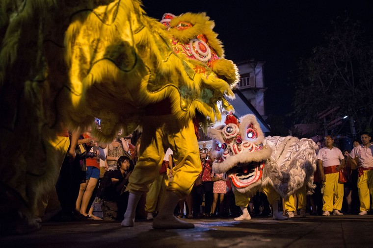 A group performs a dragon dance on February 19, 2015 in Bangkok, Thailand. February 19 marks the first day of the Chinese lunar calendar and is celebrated amongst Bangkok's significant ethnically Chinese population. (Photo by Taylor Weidman/Getty Images)